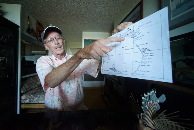 Ken Kasik points to a 'safe' area where he was stationed near Enewetak Atoll, but later found out no where was safe due to the scores of nuclear/hydrogen bomb detonations and radiation contamination around perimeter of the coral atolls. 4 jan 2015. photograph Cory Lum/Civil Beat
