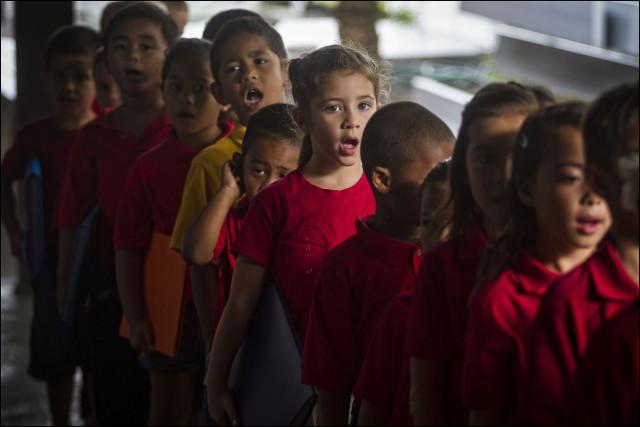 Students sing during start of day protocol at the  Nawahiokalani'opu'u Hawaiian Immersion School in Keaau, Hawaii.