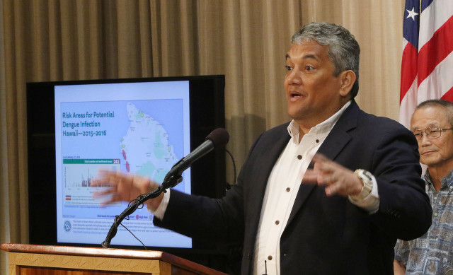 Gov. David Ige and Hawaii County Mayor Billy Kenoi, shown here at a Feb. 2 press conference, have both praised the state and county's response to the dengue outbreak.