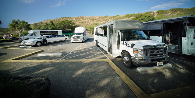 Buses and limousines parked at Hanauma Bay Nature Reserve.