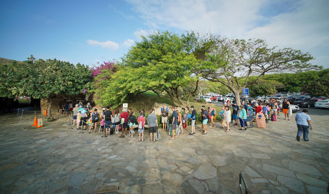 Visitors form a quick moving line at the entrance Hanauma Bay Nature Reserve to pay their $7.50 per person and watch a mandatory video.