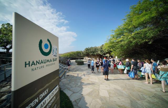 Visitors form a quick moving line at the entrance Hanauma Bay Nature Reserve.