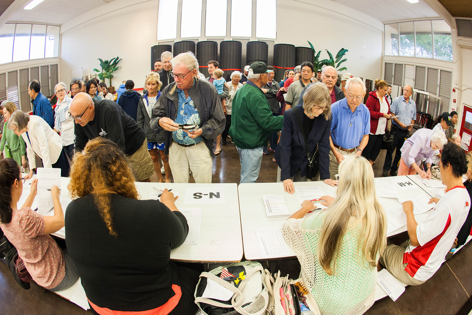 <p>March 8: Hawaii Republicans overwhelmingly supported Donald Trump in the GOP caucuses. These voters cast their ballots at Kalani High School. <em>Anthony Quintano/Civil Beat</em></p>