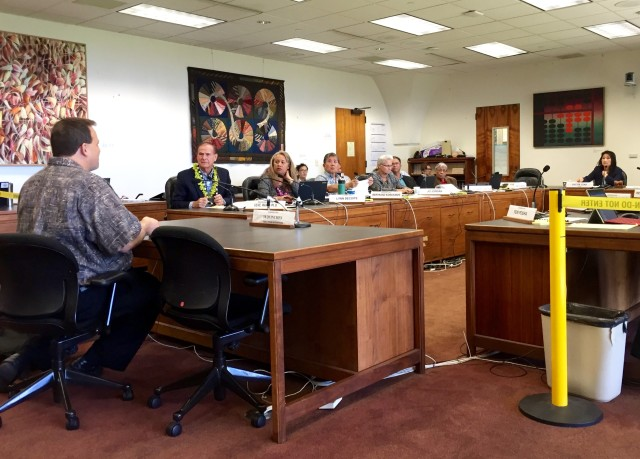 Hawaii State Teachers Association President Corey Rosenlee, left, tells the House Finance Committee on Tuesday that Campbell High School is overcrowded.