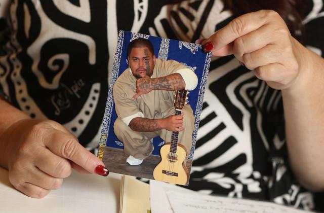 Mahealani Meheula holds Kelena Neula portrait photograph. 25 march 2016.