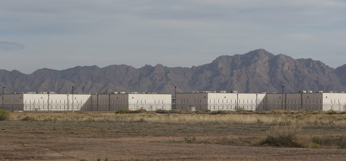 Saguaro Correctional Center CCA Fence CCA mountains Eloy Arizona1