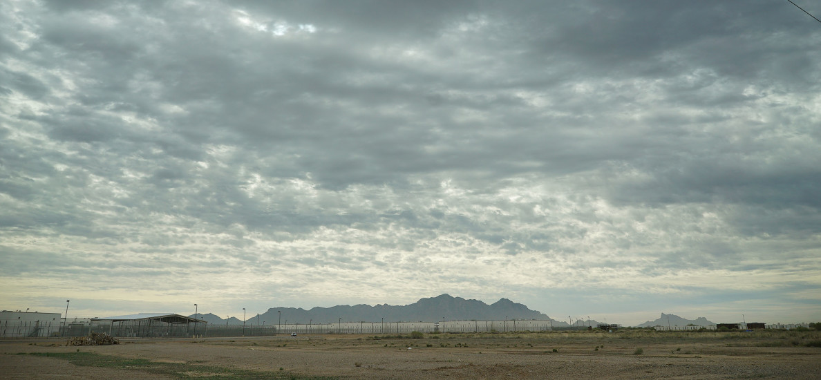 Saguaro Correctional Center Eloy Arizona clouds and mountain range. 6 march 2016. photograph Cory Lum/Civil beat