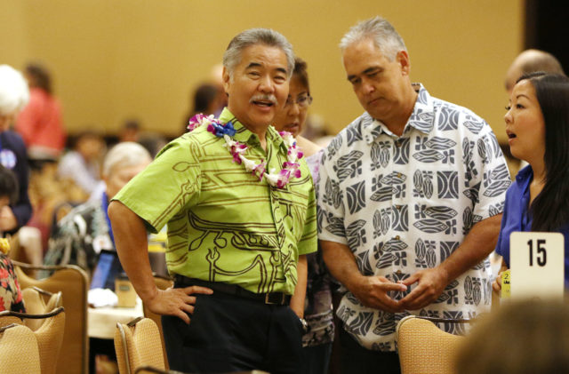 Governor David Ige and Chief of Staff Mike McCartney chat before the start of the Democratic Convention held at the Sheraton Hotel. 28 may 2016.