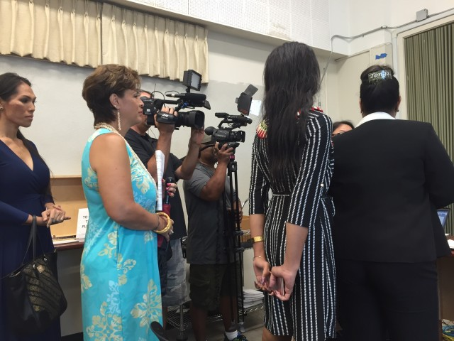 Trans community leaders sign in at Tuesday's Board of Education meeting.