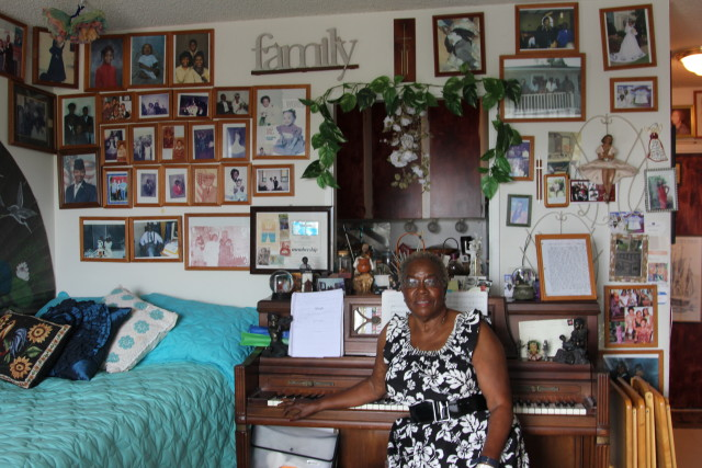 Nellie Miller sits at her piano in her one-bedroom unit at Pearlridge Gardens & Tower across from the mall. She is frustrated by rising maintenance fees that make it difficult for her to afford food and medicine.