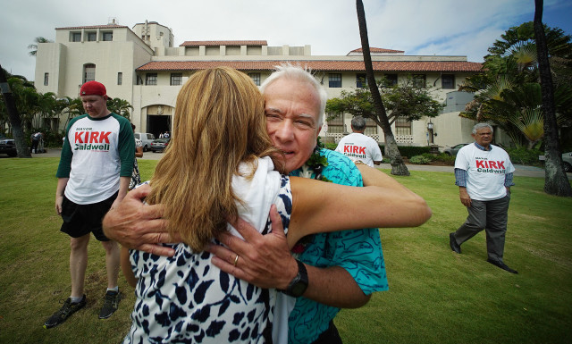 Mayor Kirk Caldwell gets a hug from a supporter before he files his papers to run for mayor at Honolulu Hale. 4 may 2016.