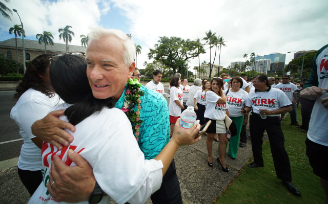 Mayork Kirk Caldwell hugs a supporter on the lawn fronting Honolulu Hale after filing papers to run for Mayor at the City Clerk's office. 4 may 2016.