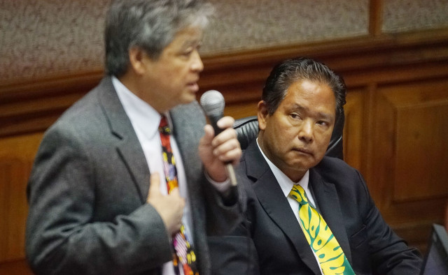 Right, Rep Marcus Oshiro looks on Rep Takumi floor session. 3 may 2016.