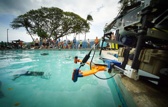 Students and judges crowd around the swimming pool during the MATE Oahu Regional Competition held at US Coast Guard Base Honolulu. 14 may 2016.