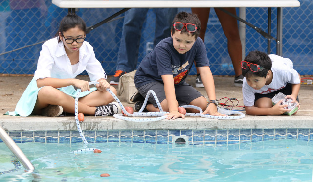 Right, Kaneohe Elementary School 5th grader, Evan Yasutake maneuvers their underwater robot during the MATE Oahu Regional Competition held at US Coast Guard Base Honolulu. 14 may 2016.