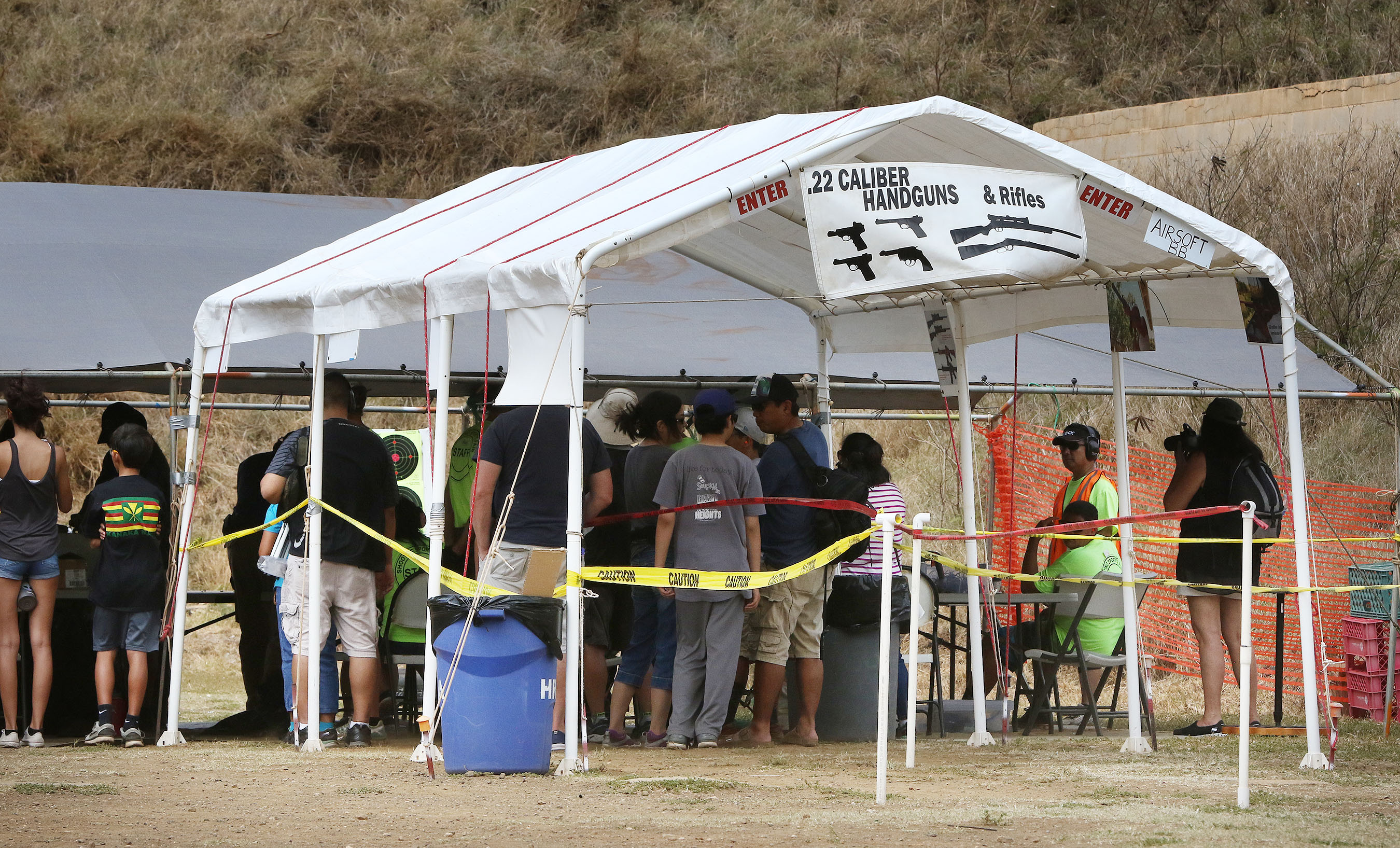 <p>Scores of people gathered in Hawaii Kai to fire guns at the 23rd annual event. The list of available weapons included tactical shotguns, big game rifles and &#8220;military small arms,&#8221; according to promotional material.</p>