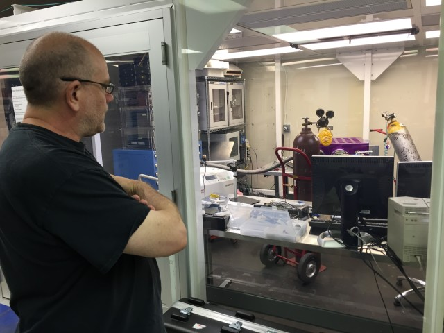Ken Chambers shows the camera system going through leak testing in the lab at the Institute for Astronomy in Manoa