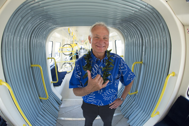 Honolulu Mayor Kirk Caldwell gives a shaka inside Honolulu Rail's first train car.