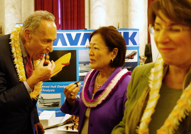 NY Senator Chuck Schumer grinds his favorite SPAM creation with Senator Mazie Hirono and right, Senator colleague at Hawaii on the Hill. 8 June 2016.