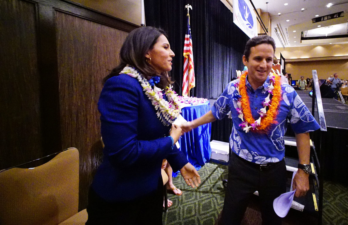 Senator Brian Schatz is greeted byt Congresswoman Tulsi Gabbard after Schatz gave speech during Hawaii State Democratic Convention. 29 may 2016