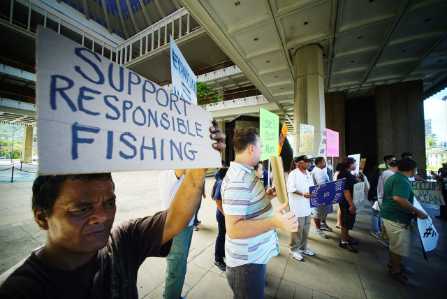 Scores holds sign in support of Fishing Means Food during a press conference/rally held in the Rotunda of the Capitol building. 26 july 2016