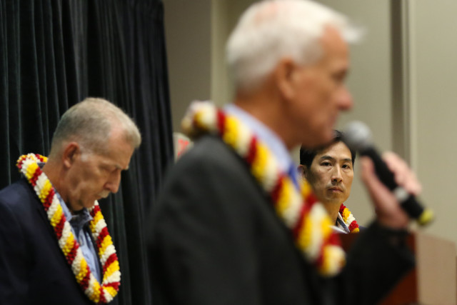 Mayor Caldwell responds to questions as Charles Djou looks on. 14 july 2016