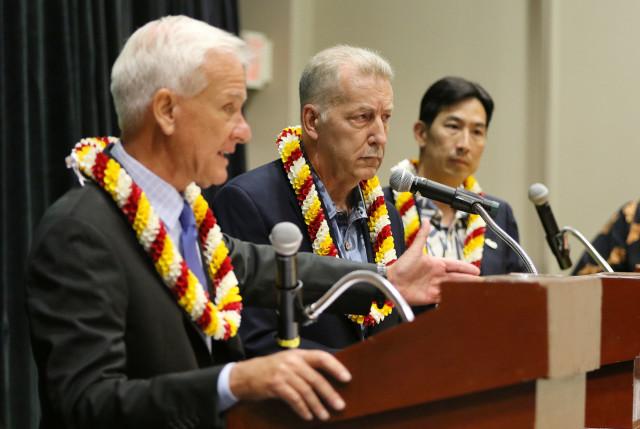 Honolulu Mayor debate as candidate Peter Carlisle looks on as Mayor Caldwell speaks with right, Charles Djou. Blaisdell. 14 july 2016