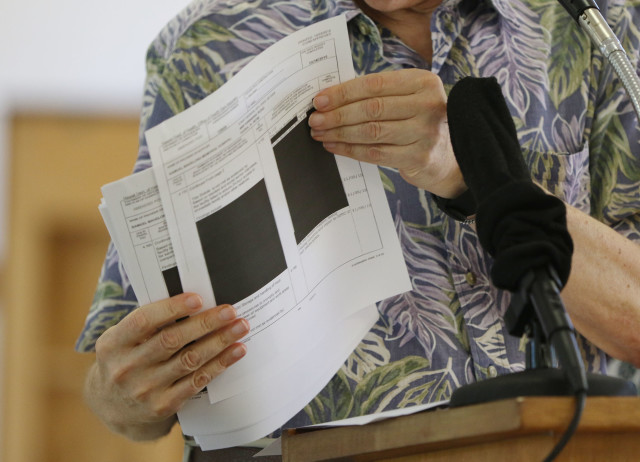 Larry Geller holds redacted documents during the Kokua Council press conference held at Harris Methodist Church. 25 july 2016