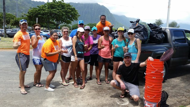 Bright t-shirts and buckets call attention to 808 Cleanups volunteers, Loftin said.