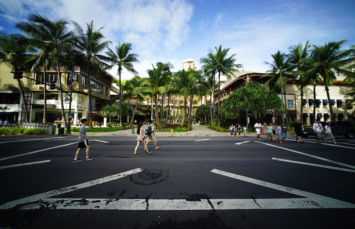 Pedestrians use diagonal crosswalks at Kalakaua Avenue near Seaside Avenue. Fronting Royal Hawaiian Shopping Center. 31 july 2016
