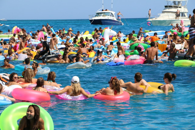 Law enforcement estimated 1,000 people took part in the July 4 flotilla off the coast of Waikiki, and had to help rescue 300.