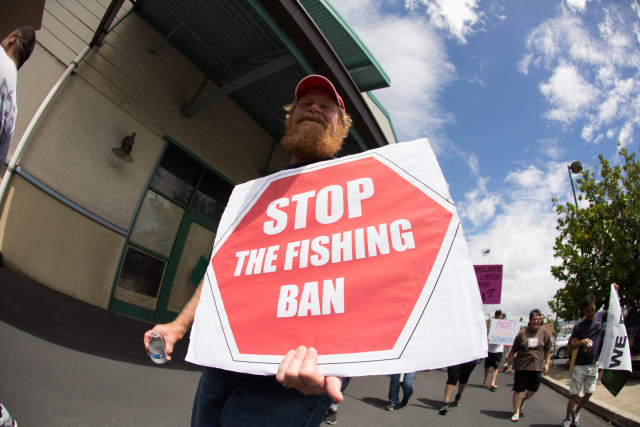 The advocacy group Fishing Means Food holds a rally at Pier 38 to protest a fishing ban in proposed Papahanaumokuakea Marine National Monument.