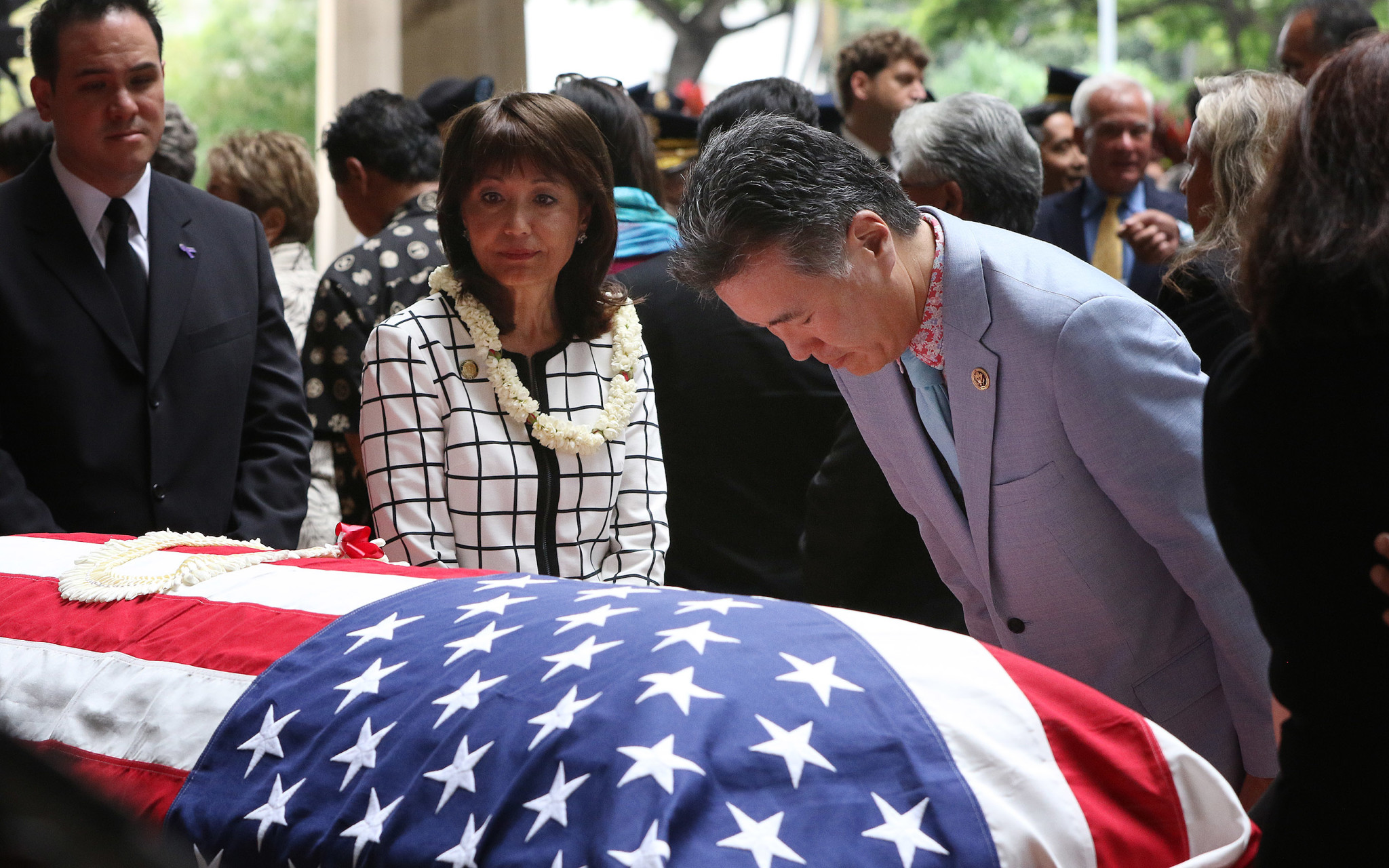 <p>California Congressman Mark Takano bows his head at Takai&#8217;s casket, as state Sen. Donna Mercado Kim and state Rep. Aaron Ling Johanson wait to pay their respects.</p>