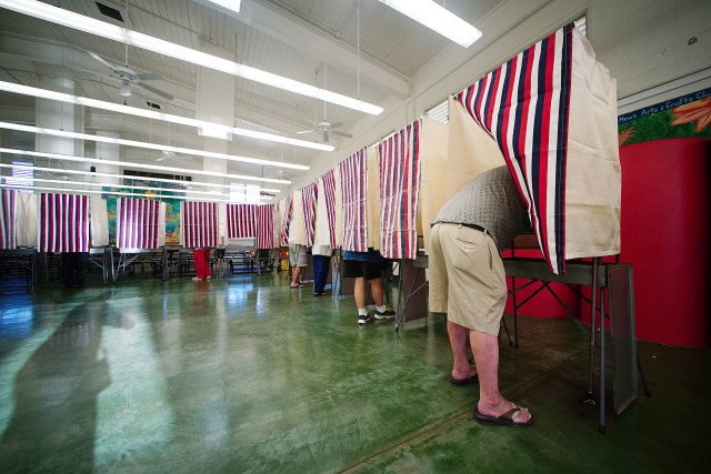 Polling booths at Kawananakoa Middle School cafeteria during the primary election day. 13 aug 2016