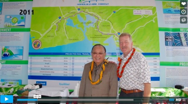 The late senator with the former mayor in from of a map of Honolulu rail.