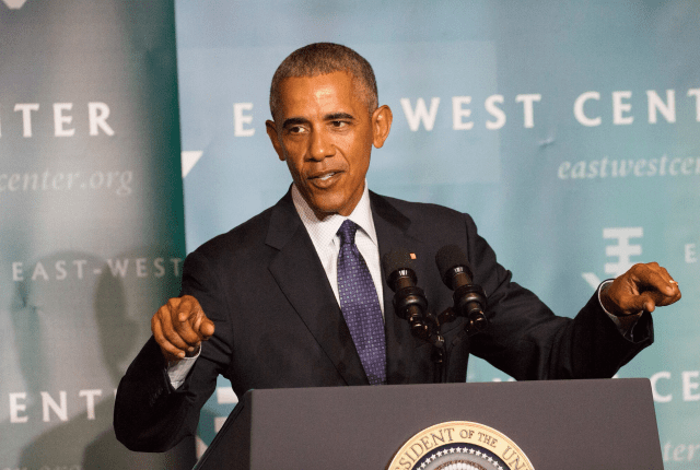 President Barack Obama speaks at the East-West Center in Honolulu on Wednesday night. This image needs to be straigtened. crooked.
