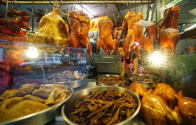 Roasted pork, chicken and duck hangs at Oahu Market in Chinatown.