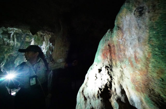 Emily Sablan guides us thru Guam Ritidian National Wilderness Refuge caves with right, some ancient Chamorro handprints. 22 aug 2016
