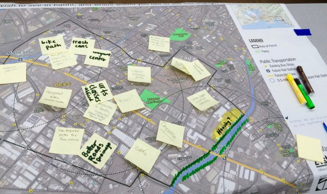 """Community members create a """"wish map,"""" writing what they wish to see in a particular area of Kalihi."""