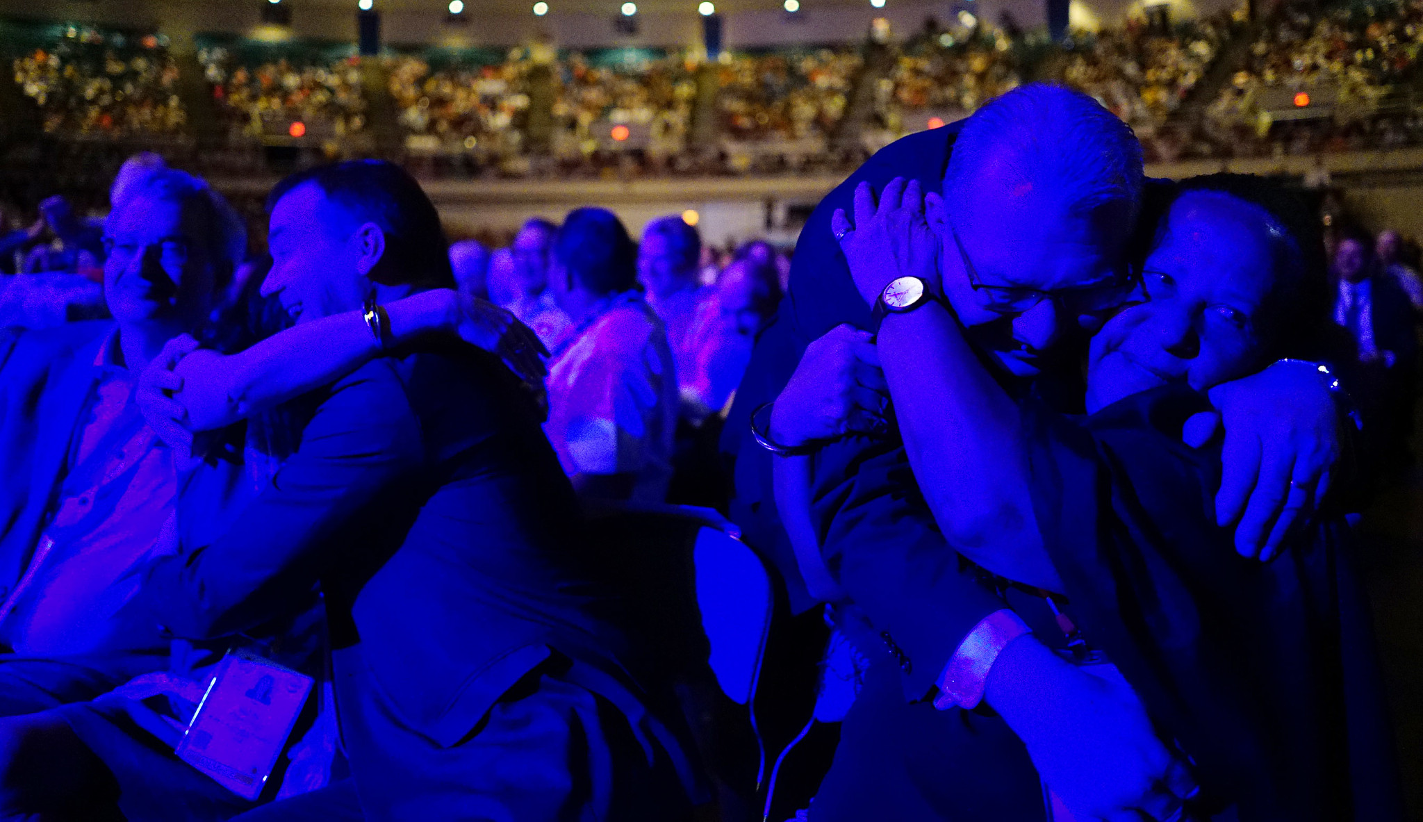 <p>Crabbe asked audience members to greet the people sitting next to them, and plenty of hugs were shared.</p>