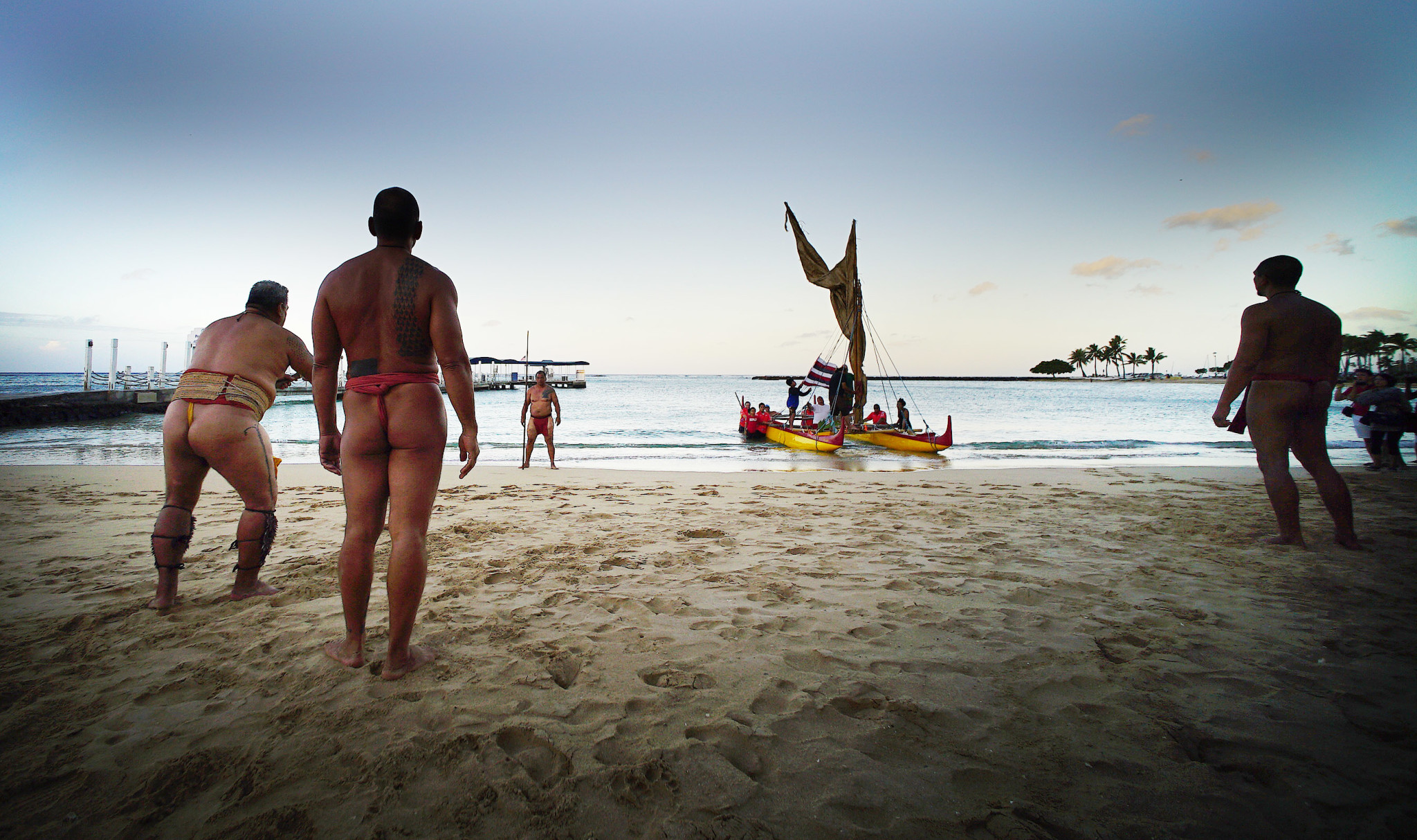 <p>In an event heralding the first morning of the World Conservation Congress, adouble-hulled canoe arrived Thursday on Waikiki Beach and was greeted by men in malo — traditional Hawaiian warrior garb— whothrew a spear and presented a welcoming gift of a coconut plant.</p>