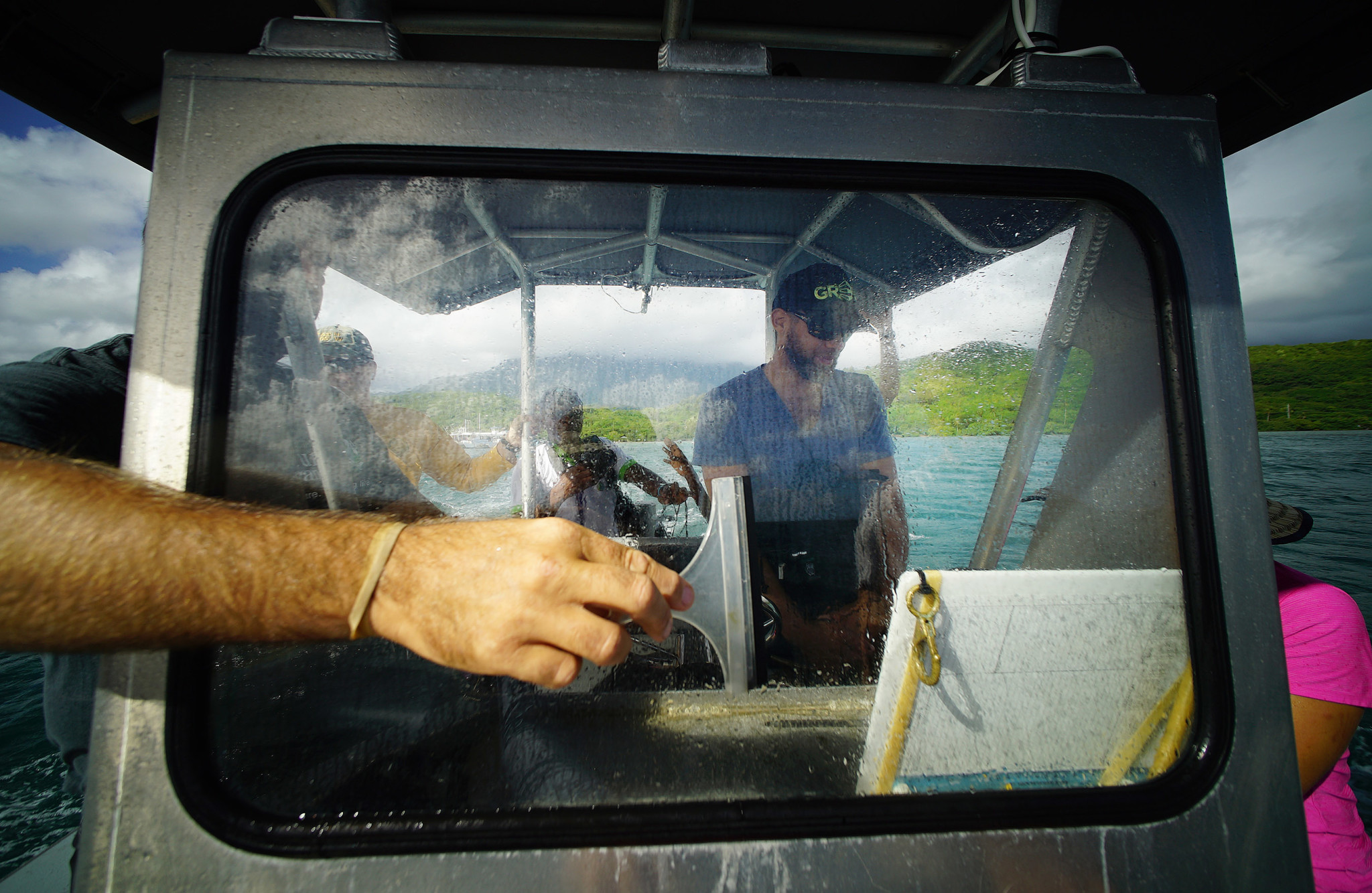 <p>Hank Lynch, of The Nature Conservancy, needed a squeegee to keep water off his windshield while taking people out on the bay to tour the coral, which in addition to bleaching faces threats from invasive algae.</p>