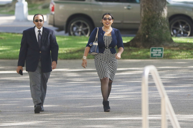 Anosh Yaqoob walks with his sister, Roheeni Yaqoob.