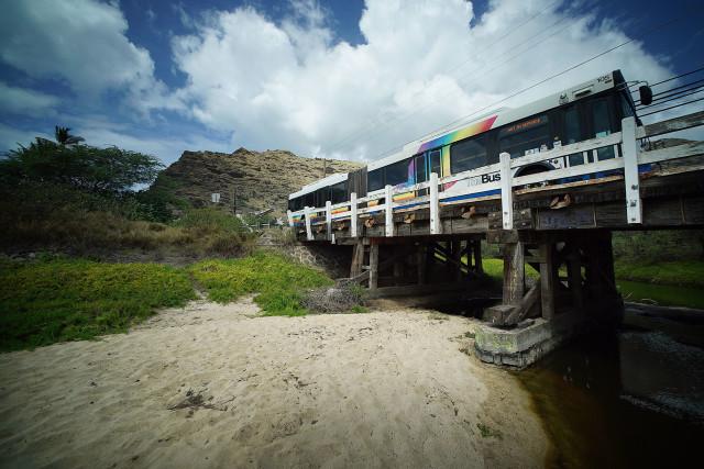 Bus traverses over wooden bridge near Makaha Beach park. 3 oct 2016