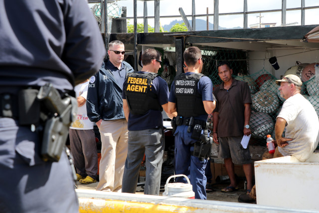 Federal law enforcement officers boarded a Hawaii longline vessel Thursday and talked to the foreign crew members.