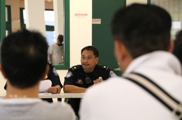 Ferdie Jose, supervisory officer for U.S. Customs and Border Protection, discusses foreign-crew issues during a quarterly meeting with longline boat owners, Thursday.