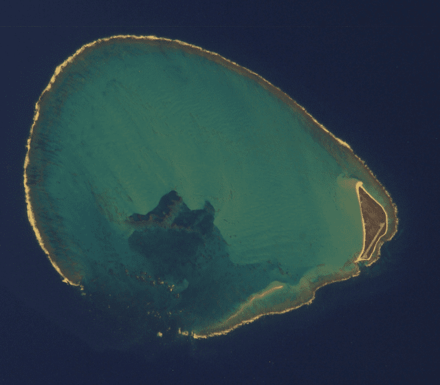 Kure Atoll, seen here in this satellite photo, with Green Island at right, was the site of yet another capsized boat.