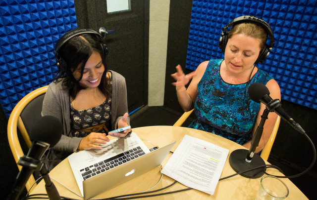 Jessica Terrell, right, and April Estrellon work on the podcast in Civil Beat's new sound studio.