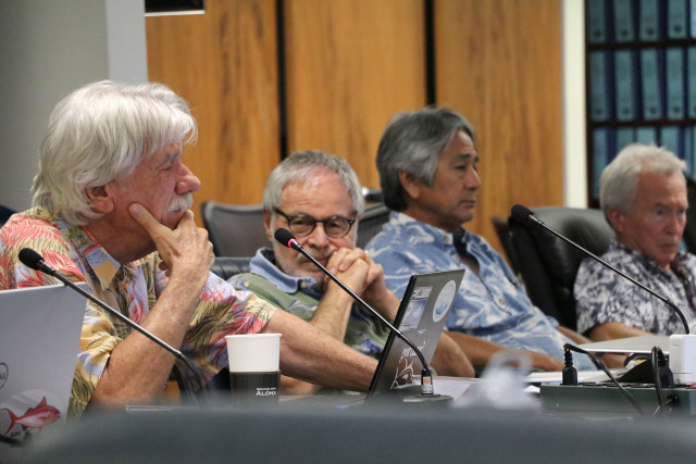 Western Pacific Regional Fishery Management Council's Scientific and Statistical Committee member John Sibert, left, considers a point during the SSC meeting, Oct. 6, 2016, in Honolulu.