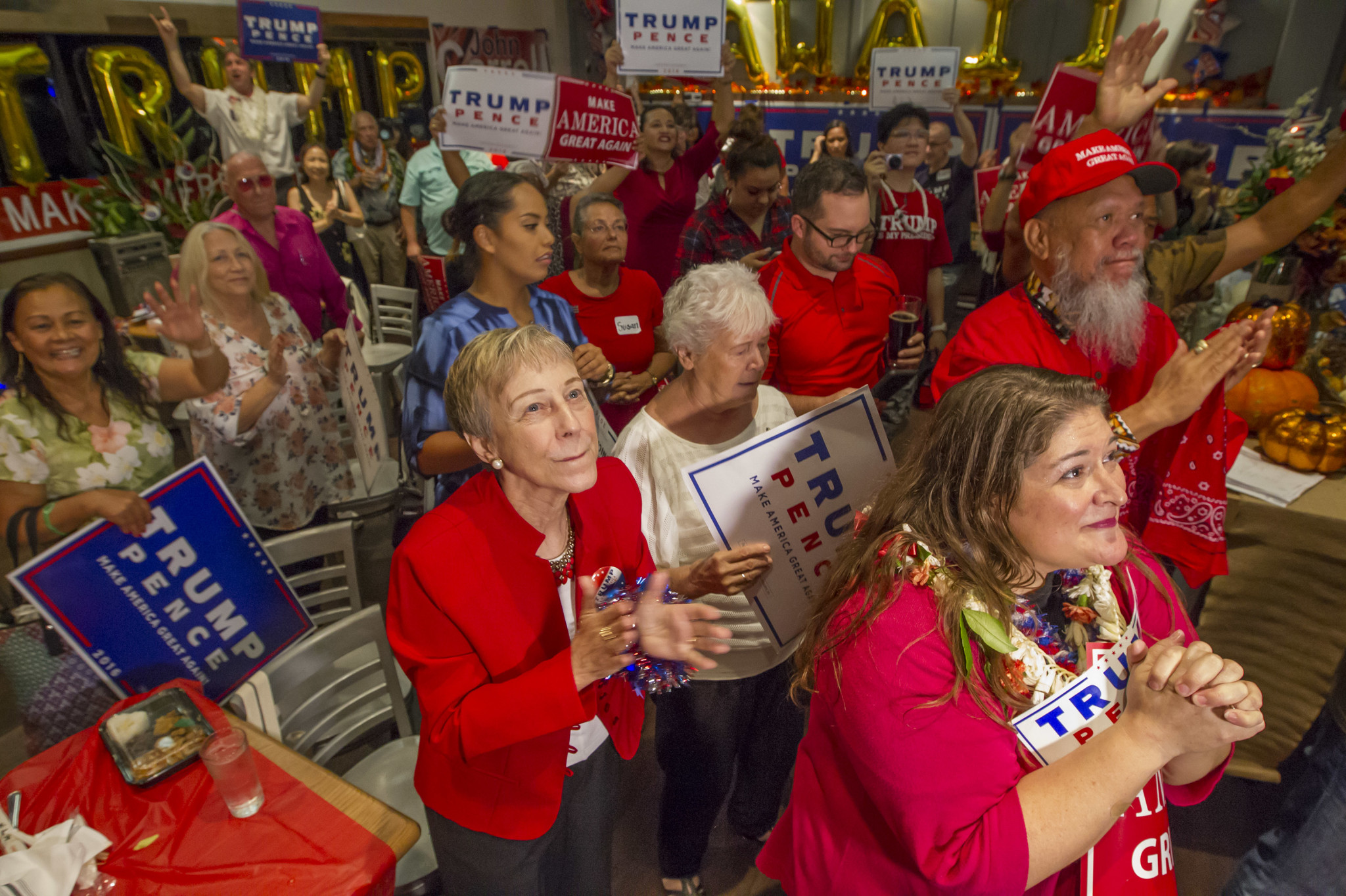 <p>Nov. 8: Trump supporters at the Irons Table + Tavern in Honolulu seem happily surprised at they learn that their candidate has won. <em>Eugene Tanner/Civil Beat</em></p>